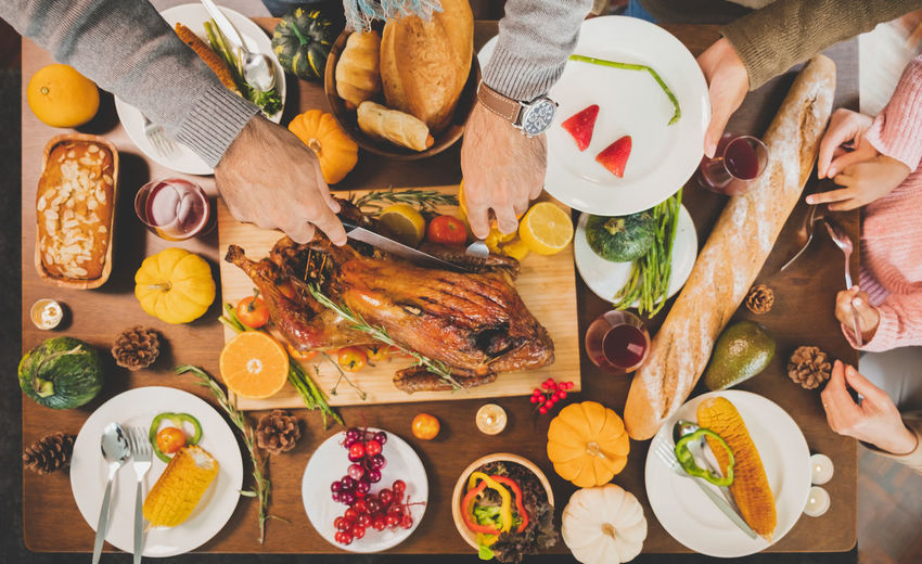 Cropped image of people eating food on table