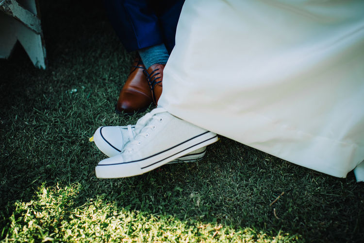 Low Section Human Leg Human Body Part Shoe Body Part Real People One Person Grass Day High Angle View Lifestyles Field Leisure Activity Human Foot Green Color Standing Unrecognizable Person Clothing Outdoors Human Limb Jeans