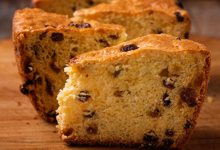 slices of home made cake with raisins on wooden plate close up Diet Panettone Baked Cake Calories Close-up Delight  Dessert Eat Fat Food Gourmet Homemade Cake Pastry Pastry Cutter Pieces Raisin SLICE Slices Snack Still Life Sweet Sweet Food Tasty Traditional