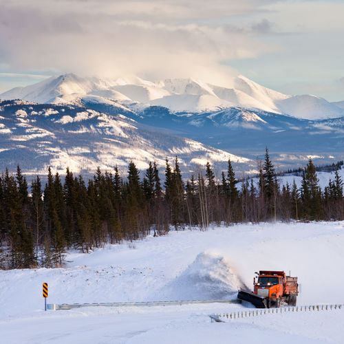 Snow plow clearing road after snow storm blizzard in beautiful rural cold winter landscape of Yukon Territory, Canada Transportation Snow Mode Of Transportation Cold Temperature Winter Nature No People Outdoors Land Vehicle Mountain Scenics - Nature Beauty In Nature Non-urban Scene Snowcapped Mountain Mountain Range Land Sky Blizzard Vehicle Snow Plough Snowplough Snowplow Snowplowing Highway Road