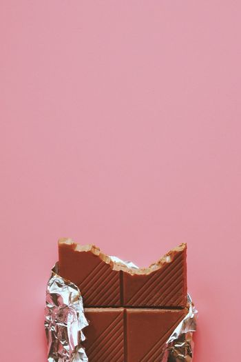 Close-up view of chocolate over pink background