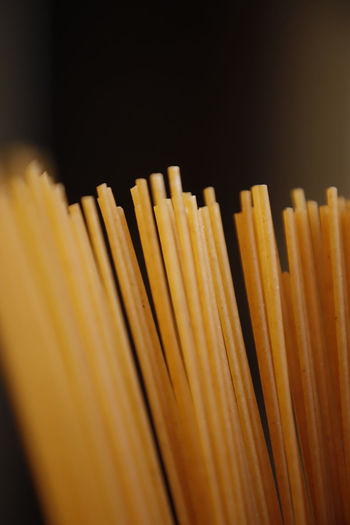 Close-up of yellow pencils against black background
