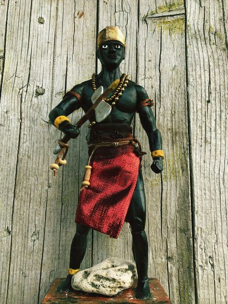 This is xango the Orixá of justice AFRICAN CULTURE Religious Icons Religious  Religion Figure Umbanda Orixas Orixas Wood - Material Day One Person High Angle View Real People Outdoors Full Length Religious Icons Religious  Religion Figure Umbanda Orixas Orixas Wood - Material Day One Person High Angle View Real People Outdoors Full Length