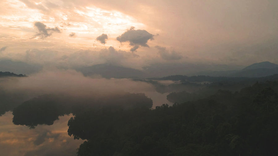 Beautiful colors was observed during sunrise with low hanging clouds travelling across the lake. Aerial, Tree, Landscape, Background, Nature, View, Green, Outdoor, Park, Forest, Land, Environment, Field, Season, Country, Travel, Beautiful, Scenery, Hill, Drone, Mountain, Panoramic, Above, Jungle, Woods, Destination, Tropical, Horizon, Wild, Breathtak Beauty In Nature Day Mountain Nature No People Outdoors Scenics Silhouette Sky Sunset Tranquil Scene Tranquility Tree