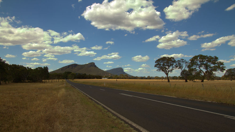 Distant Majesty Grampian National Park Beauty In Nature Cloud - Sky Day Diminishing Perspective Direction Dividing Line Environment Field Land Landscape Long Nature No People Non-urban Scene Outdoors Plant Road Scenics - Nature Sky The Way Forward Tranquility Tree
