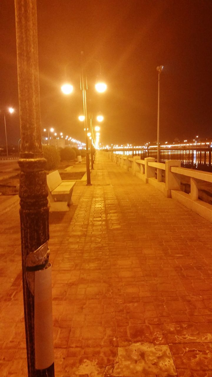 street light, illuminated, night, street, architecture, lighting equipment, built structure, transportation, city, the way forward, sky, nature, direction, building exterior, connection, bridge, outdoors, footpath, bridge - man made structure, road, diminishing perspective, no people
