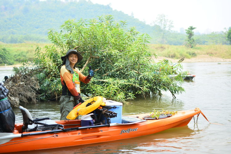 Water Outdoors Chiang Rai, Thailand Nautical Vessel Transportation Mode Of Transportation Real People One Person Nature Lifestyles Lake Day Oar Leisure Activity Safety Life Jacket Women Adult Plant