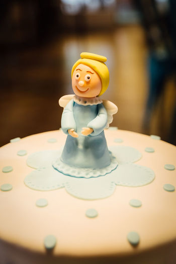 Sugar paste angel on cake Cakes Food And Drink Icing Art And Craft Baptism Cake Celebration Close-up Creativity Figurine  Focus On Foreground Fondant  Food Food And Drink Human Representation Indoors  Representation Selective Focus Smiling Still Life Sugar Paste Sweet Table