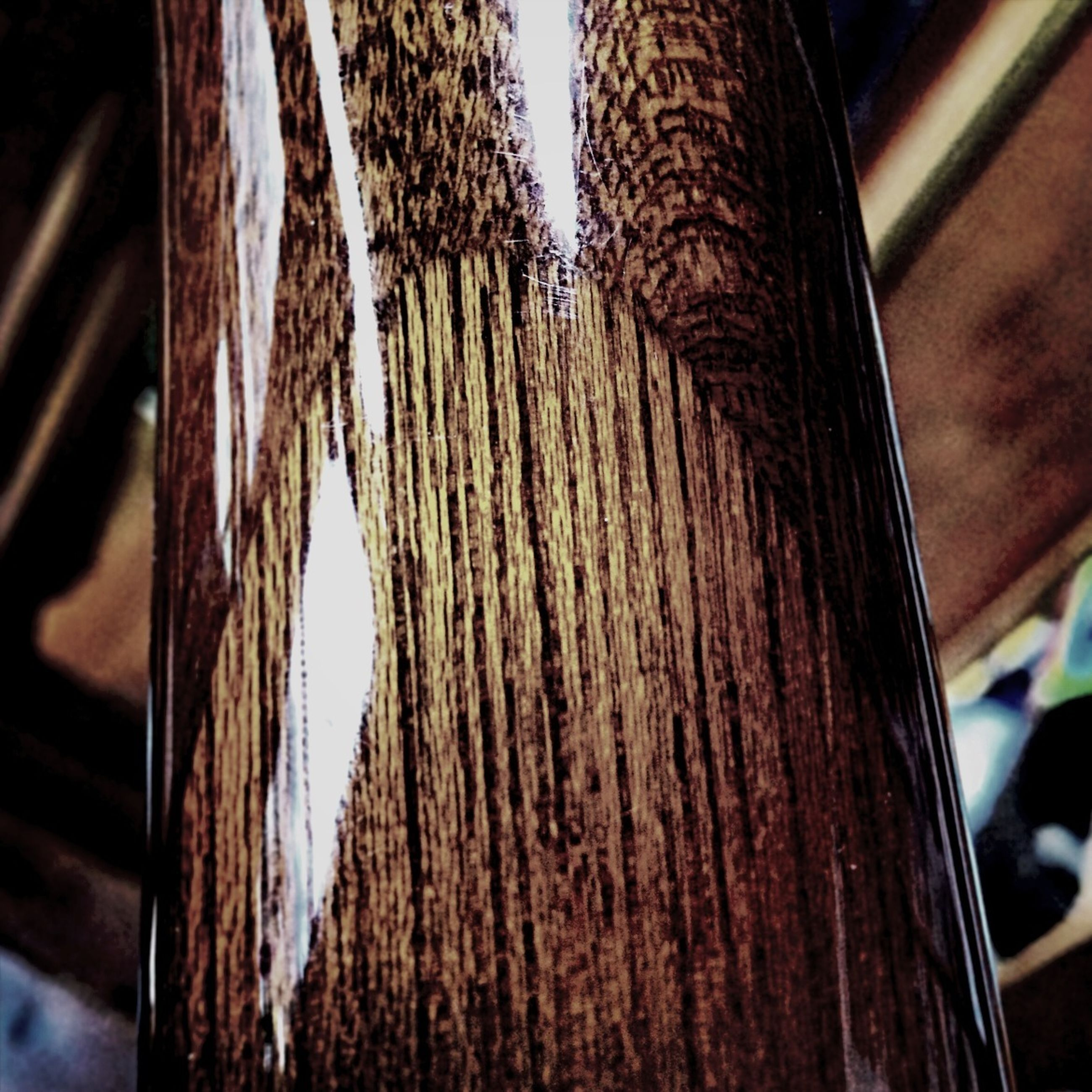 focus on foreground, close-up, hanging, wood - material, pattern, indoors, metal, selective focus, fence, day, protection, no people, safety, rope, sunlight, textured, tree trunk, part of, detail