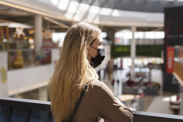 Rear view of woman standing at mall
