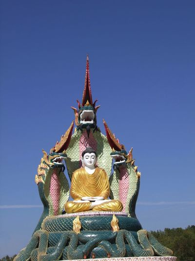 Buddha protected by Cobras Statue at Bodi Tataung Giant Buddhas Animal Representation Blue Sky Bodi Tataung Giant Buddhas Buddha Statue Buddhism Buddhism Symbols Buddhist Art Buddhist Culture Cobras Composition Famous Place Human Representation Monywa Myanmar Outdoor Photography Place Of Pilgrimage Place Of Prayer Place Of Worship Religion Sunlight Tourism Tourist Attraction  Tourist Destination Travel Destination