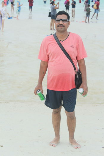 Portrait of man standing on beach