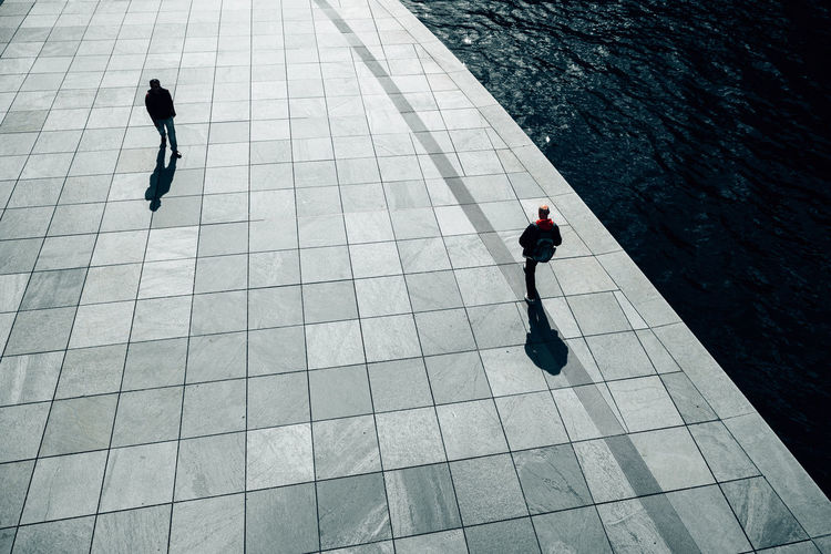 High angle view of men walking on promenade