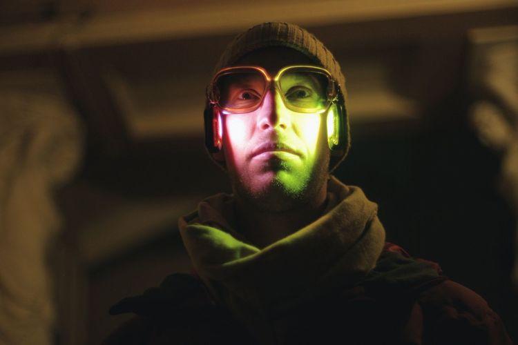 Close-up of man wearing illuminated headphones