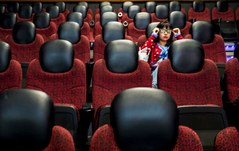 Adult Arts Culture And Entertainment Auditorium Chair Contemplation Education Empty Film Industry Group Of People In A Row Indoors  Leisure Activity Luxury Movie Theater People Rear View Red Relaxation Seat Sitting Stage Theater