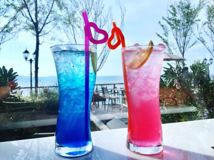Drink Refreshment No People Blue Cold Temperature Drinking Straw Tree Food And Drink Day Freshness Drinking Glass Table Outdoors Close-up Sky