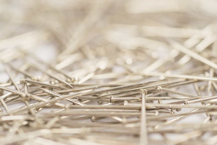 Close-up of pins on table