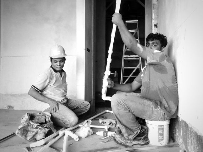 Workers working on a construction site. I asked whether they allow me to take a snapshot? Luckily I got the permission. Learn & Shoot: Working To A Brief Blackandwhite Black & White Black And White Photography Real People People People Photography Strangers Workers Construction Construction Site Plumber Plastic Human Representation Untold Stories