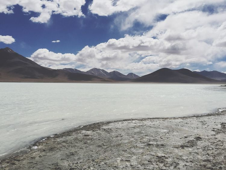 Mountain Tranquility Nature Tranquil Scene Sky Scenics Cloud - Sky Beauty In Nature Day Mountain Range Outdoors No People Landscape Salt Flat Physical Geography Travel Destinations Arid Climate Water Salt - Mineral Perspectives On Nature