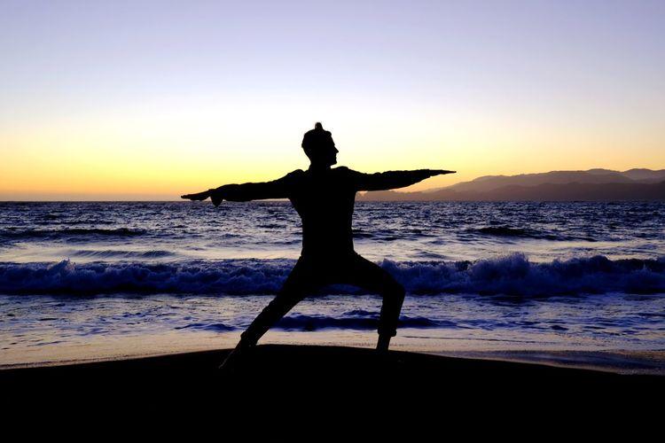 A Peaceful Sunset Yoga Silhuoette Waves Beach