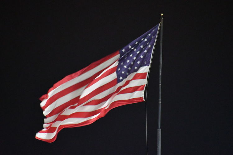 Low angle view of flag against the sky
