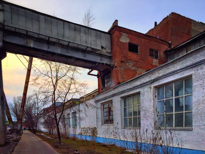 Architecture Built Structure Building Exterior Building Sky Window Nature Outdoors Clear Sky House Residential District Bridge - Man Made Structure Transportation No People Connection Low Angle View Bridge Old Day City