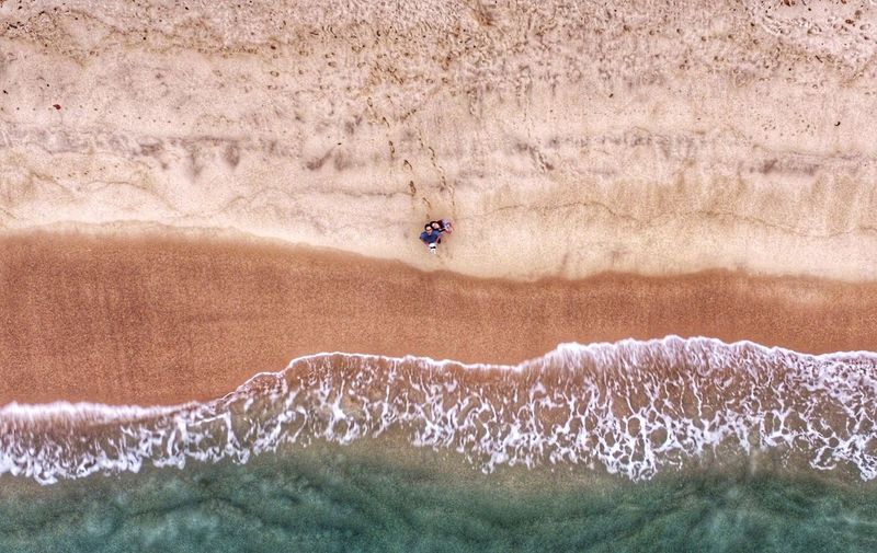 Couple Seen From Above On Beach