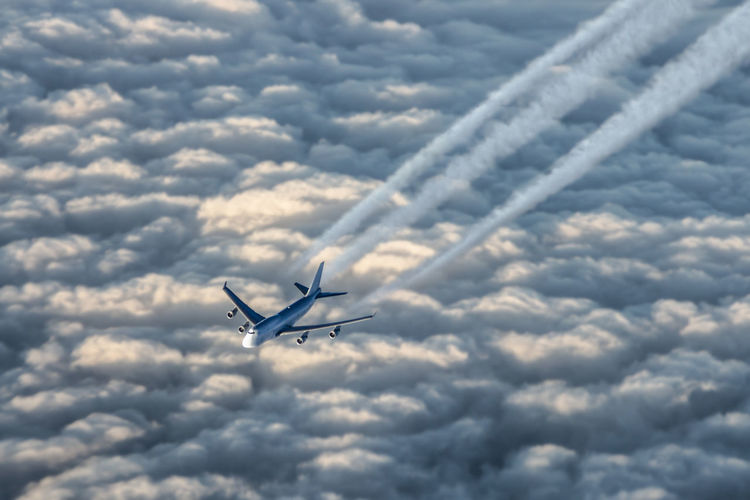 Airplane Flying In Cloudy Sky