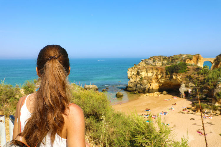 Woman with Algarve landscape Algarve Lagos Ponta Da Piedade Porto Porto Portugal Porto Portugal 🇵🇹 Portugal Rear View Beach Girl Traveler Hairstyle Horizon Horizon Over Water Lagos Portugal Lagosphotographer Long Hair Looking At View One Person Outdoors Rear View Woman Landscape Woman Portrait Woman Traveler Woman Travelling Women