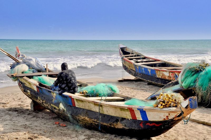 A fisherman sits in his boat
