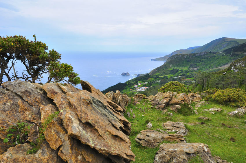 coast of death in galicia spain SPAIN Coast Of Death Galicia Spain Beauty In Nature Cloud - Sky Coast Of Death In Galicia Spain Day Grass Mountain Mountain Range Nature No People Outdoors Scenics Sky Tranquil Scene Tranquility Tree Water