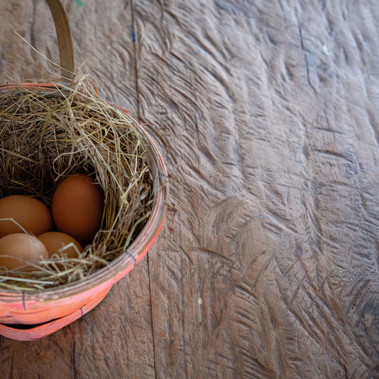 chicken eggs in basket Basket Brown Chicken Eggs Close-up Day Egg Food Freshness High Angle View Indoors  Nature No People Organic Straw Wood - Material