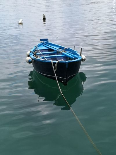 Memories Beauty Water Reflections Water_collection Calm Water Calm Sea Water Reflections Blue Water Rope Single Object Alone Forgotten Fisherboat Blue Boat Minimalism Calm Ocean Quiet Quiet Moments Quiet Places Tranquil Scene Close Up Water Nautical Vessel Boat Sailing Boat Calm Rowboat Water Vehicle Dock Rowing