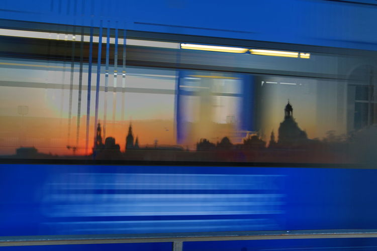 Light trails on city street seen through window