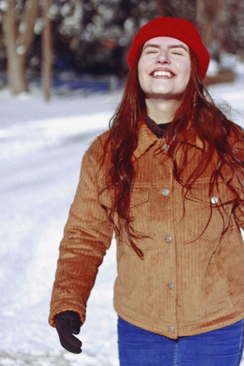 Winter, 2019 Snow Winter Cold Temperature One Person Smiling Happiness Young Adult Lifestyles Front View Portrait Young Women Cheerful Standing Women Clothing Redhead Hair Nature Leisure Activity Hairstyle Warm Clothing Outdoors Beautiful Woman Happiness Smile International Women's Day 2019