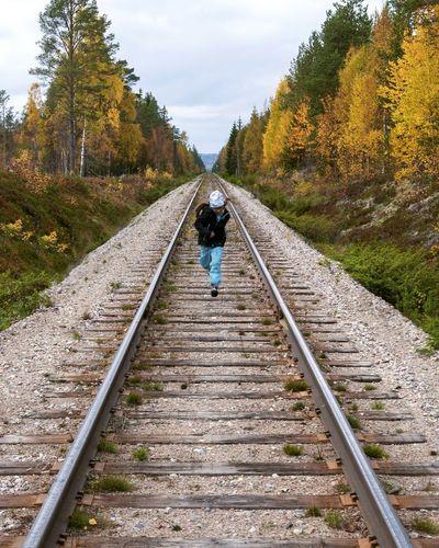 Boy Running On Railroad Track
