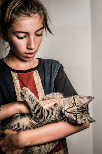 Portrait of a boy holding cat