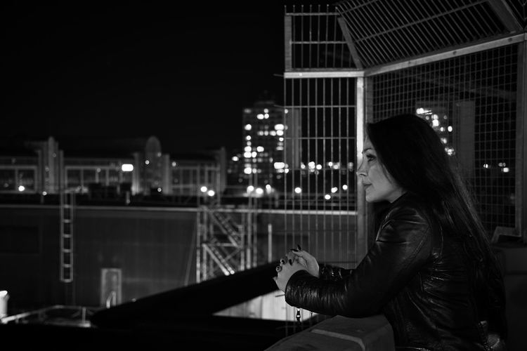 Nightphotography Citylights✨ Night Lights Portrait Of A Woman Moody Blackhair Portrait Photography Bokeh Photography Mood Captures Cityscape Pensive Rooftop Rooftops City Illuminated Women Skyscraper Urban Skyline The Portraitist - 2019 EyeEm Awards