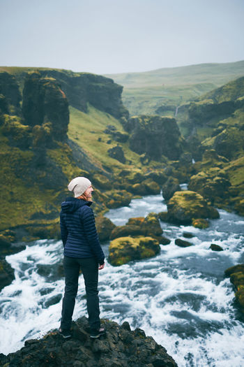 In the near of the Skogafoss, South Iceland FUJIFILM X-T2 Iceland Woman Activity Beauty In Nature Day Flowing Water Full Length Girl Idyllic Leisure Activity Lifestyles Looking At View Mountain Nature Non-urban Scene One Person Outdoors Real People Rock Rock - Object Scenics - Nature Solid Standing Water