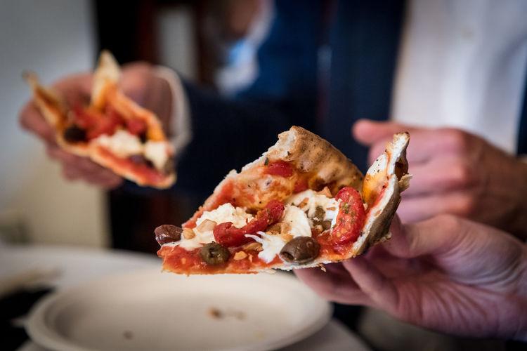 People Eating Freshly Baked Pizza