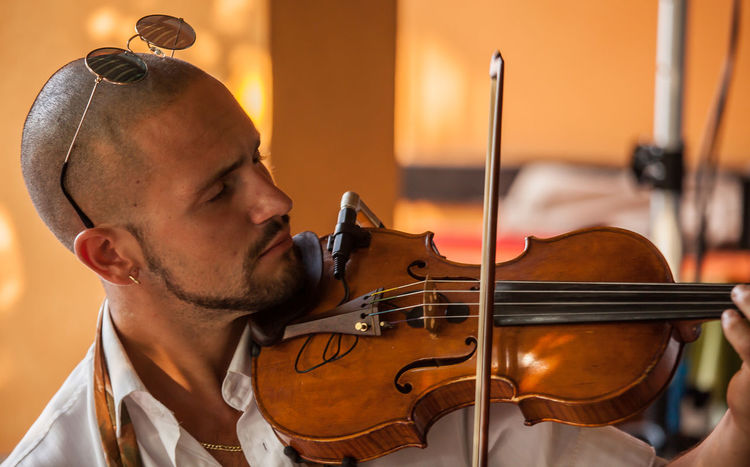 The violinist The Photojournalist - 2018 EyeEm Awards The Portraitist - 2018 EyeEm Awards The Still Life Photographer - 2018 EyeEm Awards Adult Artist Arts Culture And Entertainment Beard Bow - Musical Equipment Headshot Indoors  Men Music Musical Equipment Musical Instrument Musician One Person Performance Playing Portrait Real People Skill  String Instrument Violin Violinist Young Adult