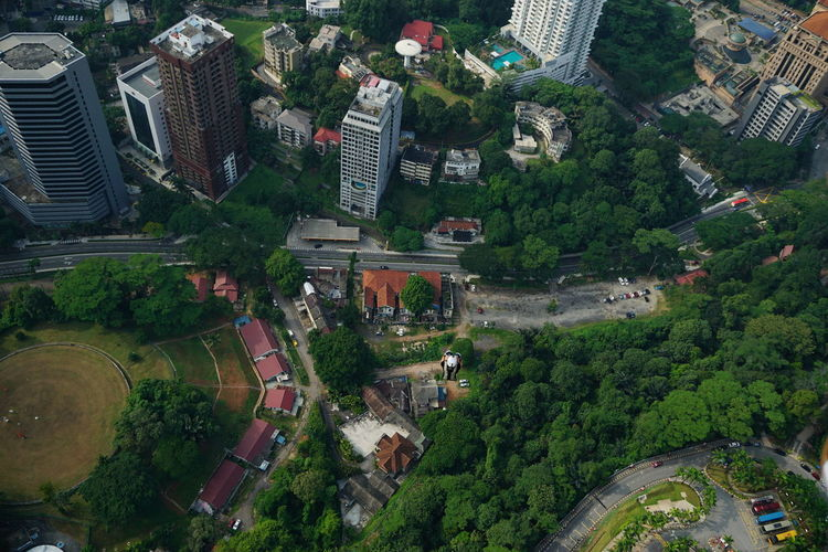 Aerial view of man base jumping over city