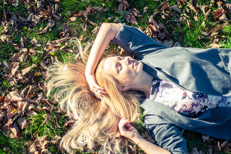 Casual Clothing Cute Day Field Grass Grassy Headshot Leisure Activity Lifestyles Lying Down Outdoors Person Portrait Relaxation Resting