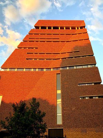 London England London EyeEm Selects Built Structure Architecture Sky Cloud - Sky Building Exterior Low Angle View Travel Destinations City Sunlight Modern Orange Color
