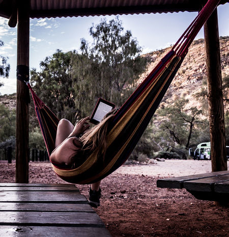 living the life in West Macdonnell ranges Hammock Kindle Australia Travel Landscape One Woman Sunlight Travel Destinations Northern Territory Desert Colorful Picnic Holiday Vacations Kindle Reading Australia Water Sky No People Love Yourself