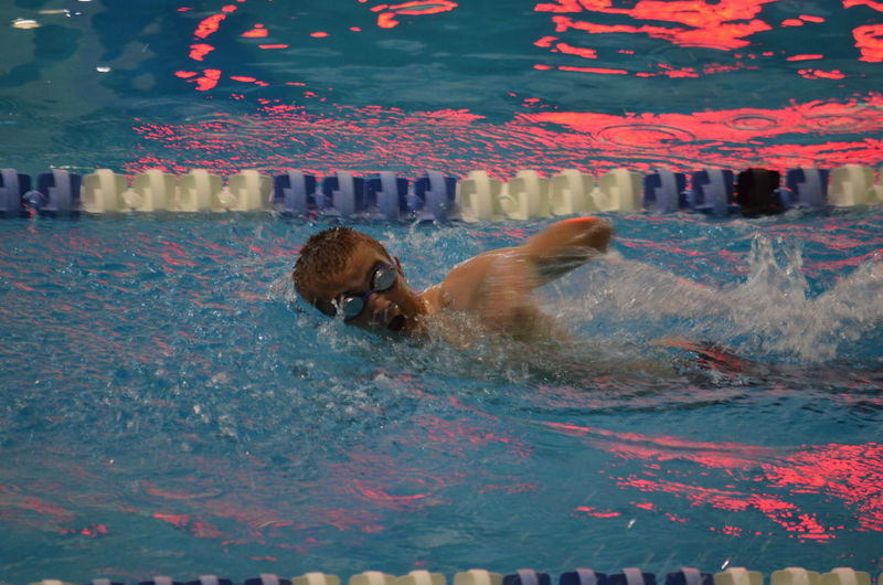 Young Swimmer In Swimming Pool