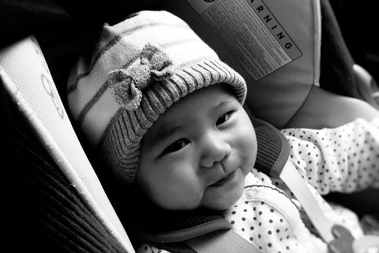 Close-Up Portrait Of Cute Baby Girl In Baby Carriage