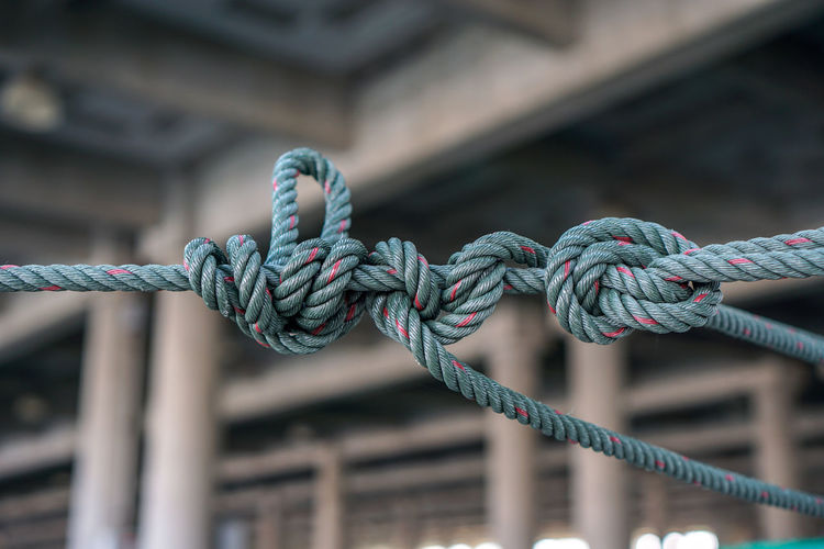 Nylon rope Strength Rope Focus On Foreground Close-up No People Day Connection Metal Tied Up Pattern Outdoors Safety Twisted Blue Security Tied Knot Wood - Material Old Cable Textured  Tangled