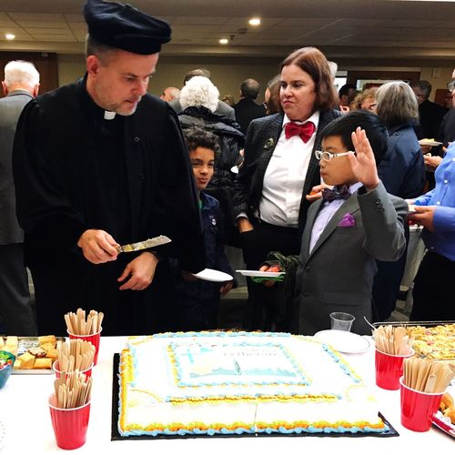 Dean Martin Malina cuts the Reformation 500 cake in Ottawa, Canada. Food And Drink Real People Pastor Ministry Lutheran Church Lutheran Ottawa Food Indoors  Men Women Mature Adult Standing Adult People Day Gown Church Reformation Day Celebrations Reformation Reformation Day