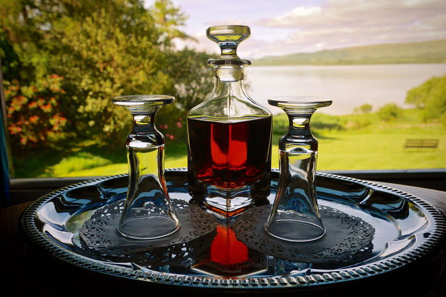 Alcoholic Drink Decanter Decanter And Glassware Doilie Drink Focus On Foreground In Shadow Silver Tray View From The Window... Water View